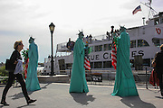 Manhattan, NY. Oct. 8 2013. A trio of Statue of Liberty impersonators in Battery Park, Manhattan.  10082013. Photo by Nicholas Wells/NYCity Photo Wire.