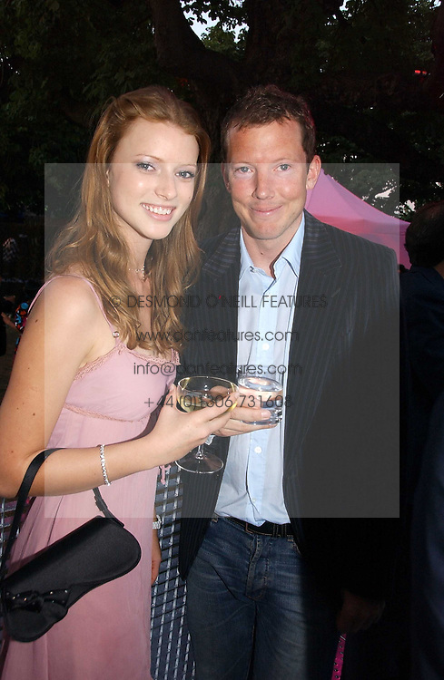 NAT ROTHSCHILD and KATIA BULLER at the Serpentine Gallery Summer party sponsored by Yves Saint Laurent held at the Serpentine Gallery, Kensington Gardens, London W2 on 11th July 2006.<br />
