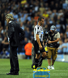 Newcastle United's Steven Taylor is sent off for a apparent elbow on Manchester City's Sergio Aguero  - Photo mandatory by-line: Joe Meredith/JMP - Tel: Mobile: 07966 386802 19/08/2013 - SPORT - FOOTBALL - Etihad Stadium - Manchester - Manchester City V Newcastle United - Barclays Premier League