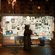 December 18, 2013 - Kiev, Ukraine: A local woman looks at Pro-EU panflets stick to the back of a bus stop in Independence Square, known locally as Maidan.<br /> On the night of 21 November 2013, a wave of demonstrations and civil unrest began in Ukraine, when spontaneous protests erupted in the capital of Kiev as a response to the government&rsquo;s suspension of the preparations for signing an association and free trade agreement with the European Union. Anti-government protesters occupied Independence Square, also known as Maidan, demanding the resignation of President Viktor Yanukovych and accusing him of refusing the planned trade and political pact with the EU in favor of closer ties with Russia.<br /> After a days of demonstrations, an increasing number of people joined the protests. As a responses to a police crackdown on November 30, half a million people took the square. The protests are ongoing despite a heavy police presence in the city, regular sub-zero temperatures, and snow. (Paulo Nunes dos Santos/Polaris)