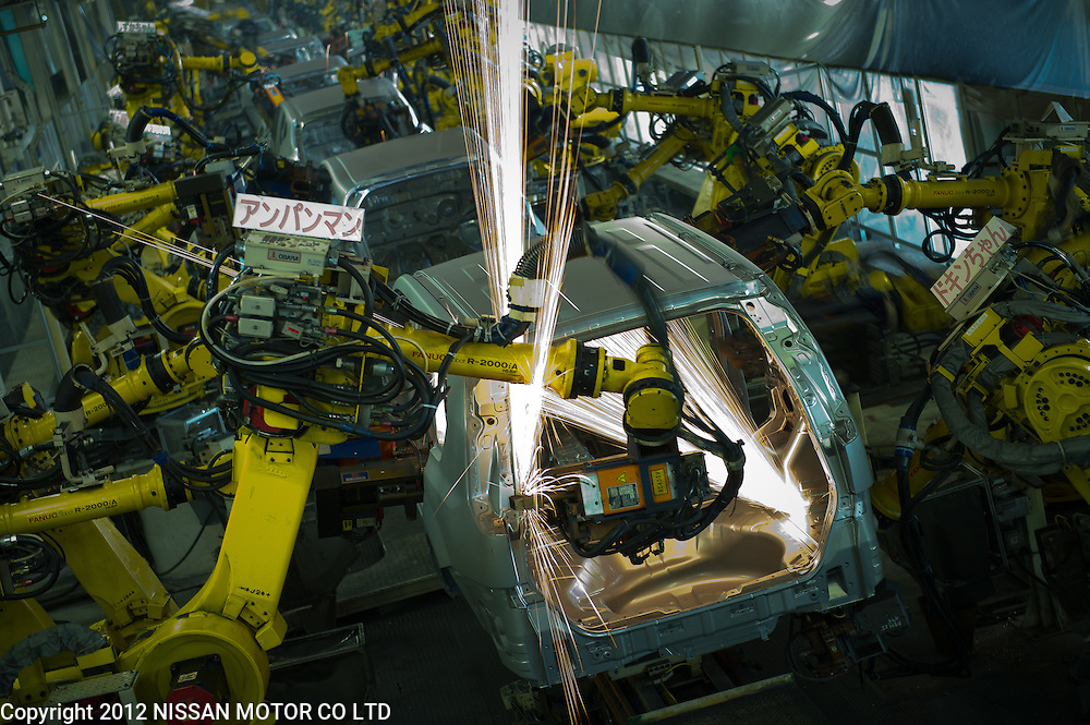 Welding robots in action at Nissan Motor Kyushu Plant.