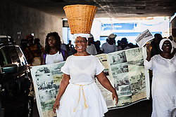 "Mary Ann Christopher plays the role of Queen Coziah who led the successful Coal Workers' Strike in 1892.  7th Annual Dollar Fo' Dollar Culture & History Tour & MIni Coaling Exhibit.  A remebrance of the 1892 Coal Workers Strike on St. Thomas ""livicated"" to Ras Jahstarr Koniyah.  Held annually in September, the tour celebrates the successful protest of 19th centry coal laborers in the streets of downtown Charlotte Amalie for better pay.  © Aisha-Zakiya Boyd"
