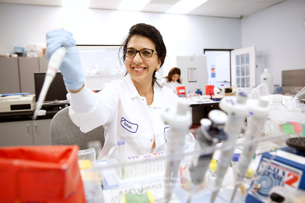Organic chemist Suhair Howayer works in the lab at Calbioteach in Spring Valley, Calif., Aug. 14, 2015.  From Baghdad, Howayer has been in the El Cajon area for two years. (Nancy Wiechec for ONE magazine)