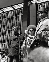 Kathleen Cleaver speaking at Mayday Black Panther rally at Federal building San Francisco 1969. Cleve Brooks on right (possibly Warren Kimbro on left)
