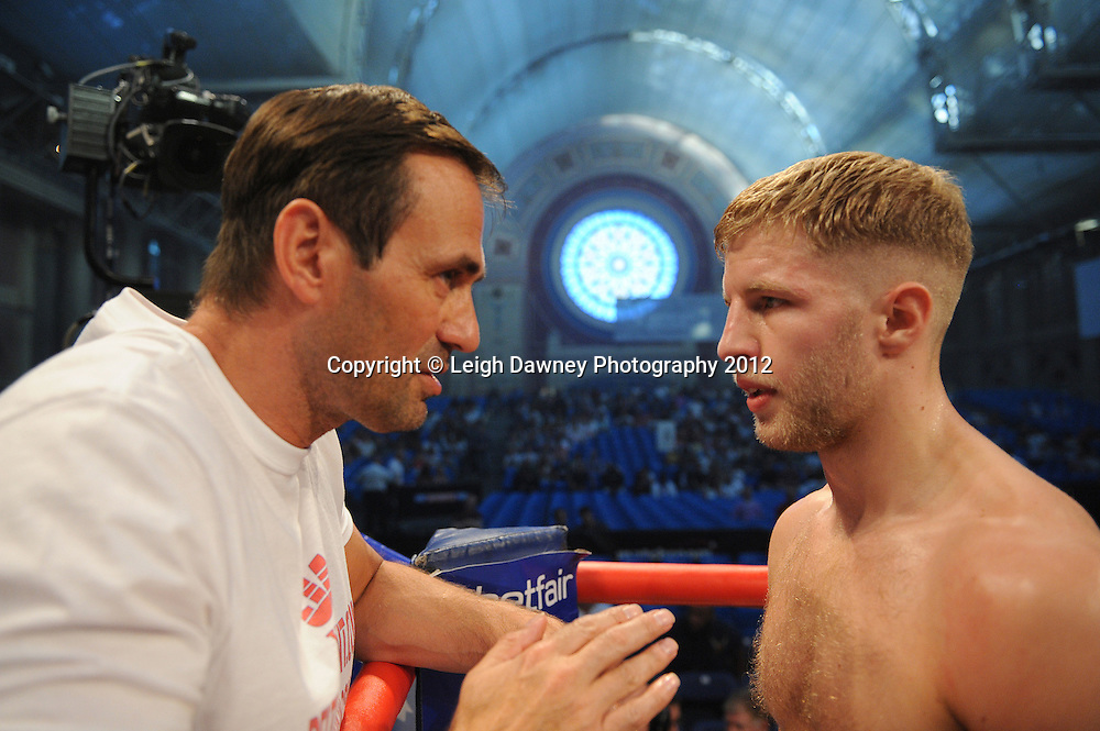 Ryan Taylor (with trainer) defeats Gyula Vajda in a 6x3 Lightweight contest at Alexandra Palace, Muswell Hill, North London on Saturday 8th September 2012. Matchroom Sport. Pictures © Leigh Dawney Photography 2012.