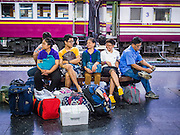 11 APRIL 2015 - BANGKOK, THAILAND:  People wait to board a train at Hua Lamphong train station in Bangkok. More than 130,000 passengers streamed through Bangkok's main train station Friday ahead of Songkran, Thailand's traditional new year celebration. Songkran will be celebrated April 13-15 but people started streaming out of Bangkok on April 10 to go back to their home provinces.   PHOTO BY JACK KURTZ