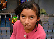 An 11-year-old Guatemalan girl, who crossed illegally from Mexico into the United States with her mother, waits at the bus station in Tucson, Arizona, USA, after U.S. authorities released the two to travel to a secondary location in the states where their immigration status will be addressed.