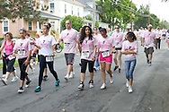 Middletown, New York - Walkers head down Wallkill Avenue in the 16th annual Ruthie Dino-Marshall 5K Run/Walk put on by the Middletown YMCA on Sunday, June 10, 2012.
