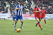 Wigan Athletic Forward, Will Grigg and currently Wigans leading Goal scorer looks runs at the Oldham defence during the Sky Bet League 1 match between Wigan Athletic and Oldham Athletic at the DW Stadium, Wigan, England on 13 February 2016. Photo by Mark Pollitt.