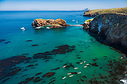 Kayaks and sailboats at Scorpion Cove, Santa Cruz Island, Channel Islands National Park, California USA