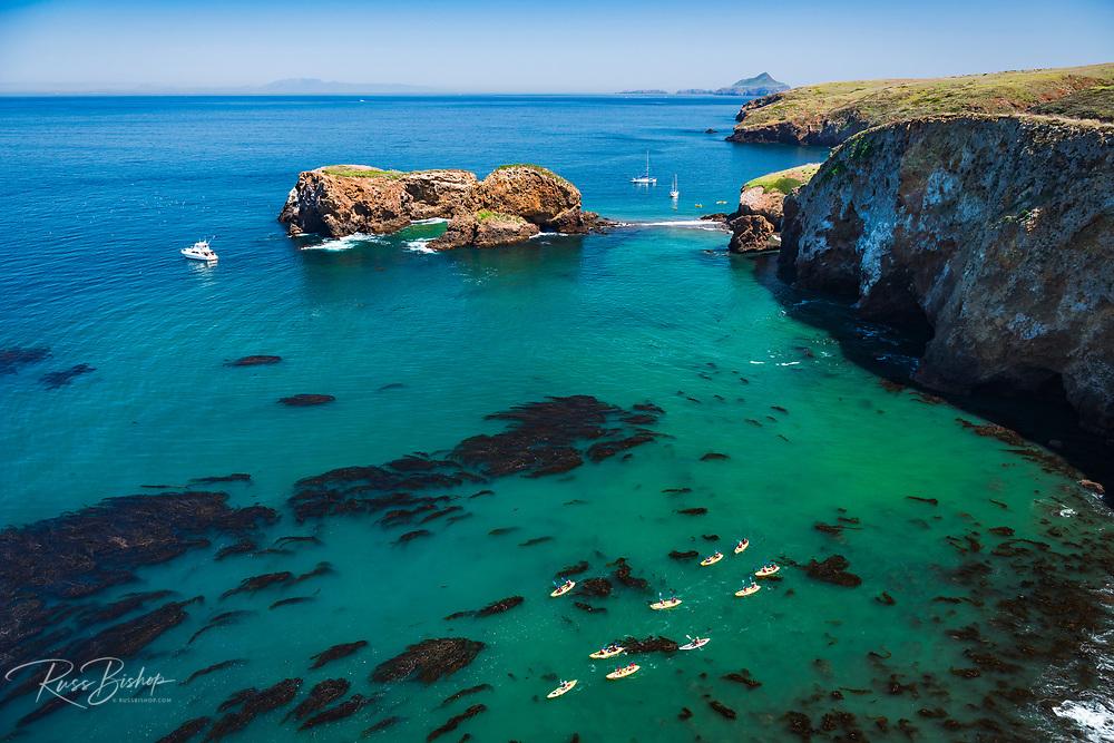 Kayaks and sailboats at Scorpion Cove, Santa Cruz Island, Channel Islands National Park, California USA