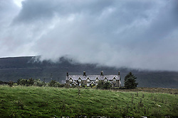 © Licensed to London News Pictures. 26/08/2015. Ribblehead, UK. Picture shows clouds covering the Whernside mountain in the Yorkshire Dales first thing this morning. Photo credit: Andrew McCaren/LNP