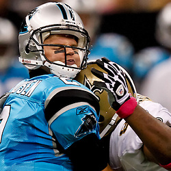 October 3, 2010; New Orleans, LA, USA; Carolina Panthers quarterback Jimmy Clausen (2) takes a hit from New Orleans Saints defensive end Will Smith (91) during the second quarter at the Louisiana Superdome. Mandatory Credit: Derick E. Hingle