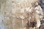 deteriorating family group portrait Japan ca 1930s