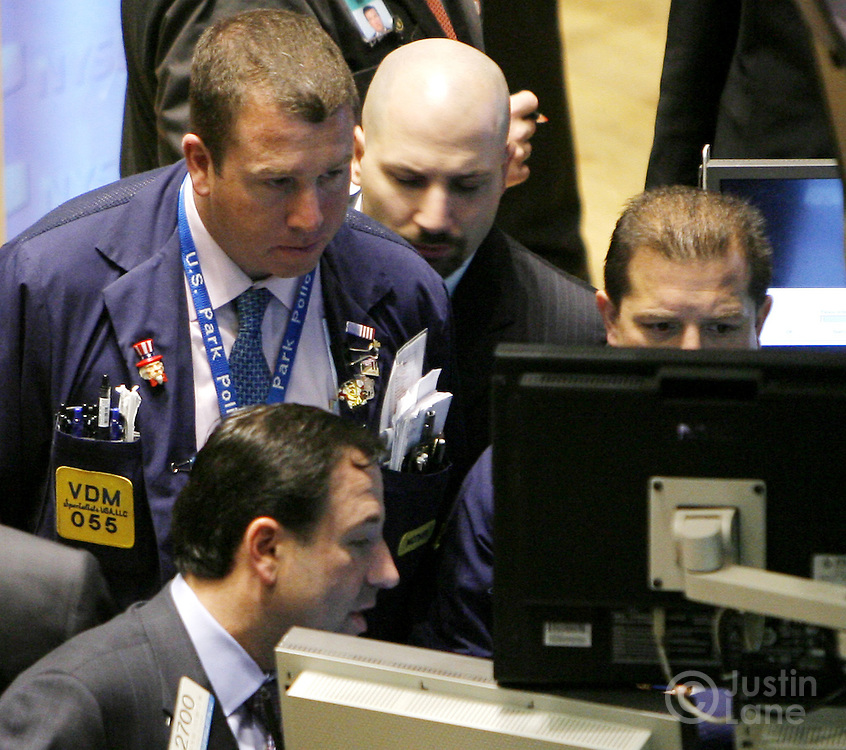 Traders work on the floor of the New York Stock Exchange at the start of trading in New York, New York on Wednesday 28 February 2007. The Dow Jones Industrial average ended down 416 points yesterday, but stocks showed some signs of rebounding on Wednesday.