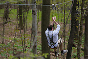 Steve Fuller, Project Manager at Bristol Mountain's new Aerial Adventure Park, descends a zipline on Tuesday, May 20, 2014.