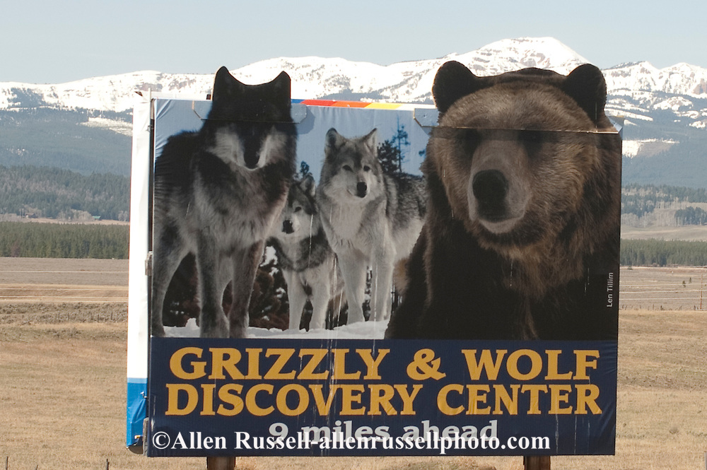 Grizzly and Wolf Discovery Center billboard outside West Yellowstone, Montana
