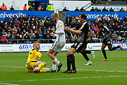 Anssi Jaakkola (31) of Reading makes a save at the feet of  Oli McBurnie (9) of Swansea City to deny swansea a goal during the EFL Sky Bet Championship match between Swansea City and Reading at the Liberty Stadium, Swansea, Wales on 27 October 2018.