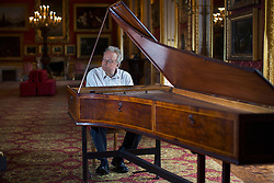 © licensed to London News Pictures. London, UK 10/05/2013. Music professor David Owen Norris plays the oldest surviving English grand piano, which has not been heard in public for at least half a century and goes on display at Apsley House in London. The piano built in London by renowned piano maker Americus Backers in 1772, , the home of its former owner, the first Duke of Wellington. Photo credit: Tolga Akmen/LNP