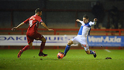 Bristol Rovers' Tom Lockyer goes in to a tackle with Crawley Town's Jamie Proctor - Photo mandatory by-line: Seb Daly/JMP - Tel: Mobile: 07966 386802 18/12/2013 - SPORT - FOOTBALL - Broadfield Stadium - Crawley - Crawley Town v Bristol Rovers - FA Cup - Replay