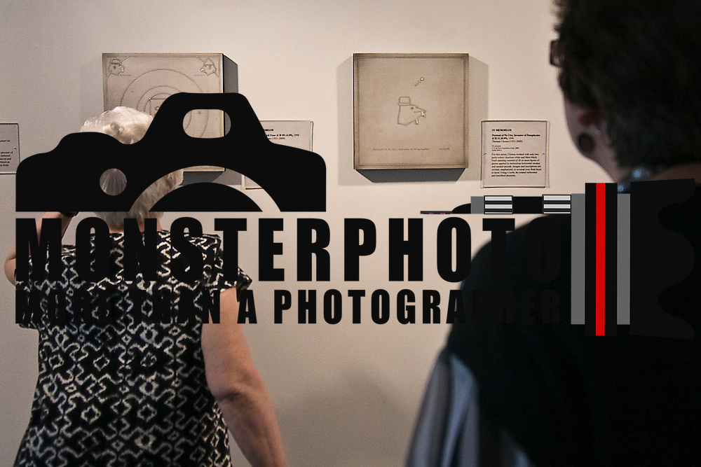 6/19/10-Wilmington DE - Dorothy vogel reviewing a Piece by Thomas Chimes 1921-2009 (Portraits of all four) at The Delaware Art Museum June 19, 2010. Learn more about the Vogel Collection, which is being distributed to 50 museums in 50 states, at www.vogel5050.org. Special to The News Journal/SAQUAN STIMPSON
