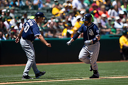OAKLAND, CA - JUNE 18:  Derek Norris #3 of the San Diego Padres is congratulated by third base coach Glenn Hoffman #30 after hitting a home run against the Oakland Athletics during the sixth inning at O.co Coliseum on June 18, 2015 in Oakland, California. The San Diego Padres defeated the Oakland Athletics 3-1. (Photo by Jason O. Watson/Getty Images) *** Local Caption *** Derek Norris; Glenn Hoffman