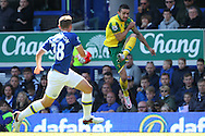 Robbie Brady of Norwich and Matthew Pennington of Everton in action during the Barclays Premier League match at Goodison Park, Liverpool<br /> Picture by Paul Chesterton/Focus Images Ltd +44 7904 640267<br /> 15/05/2016