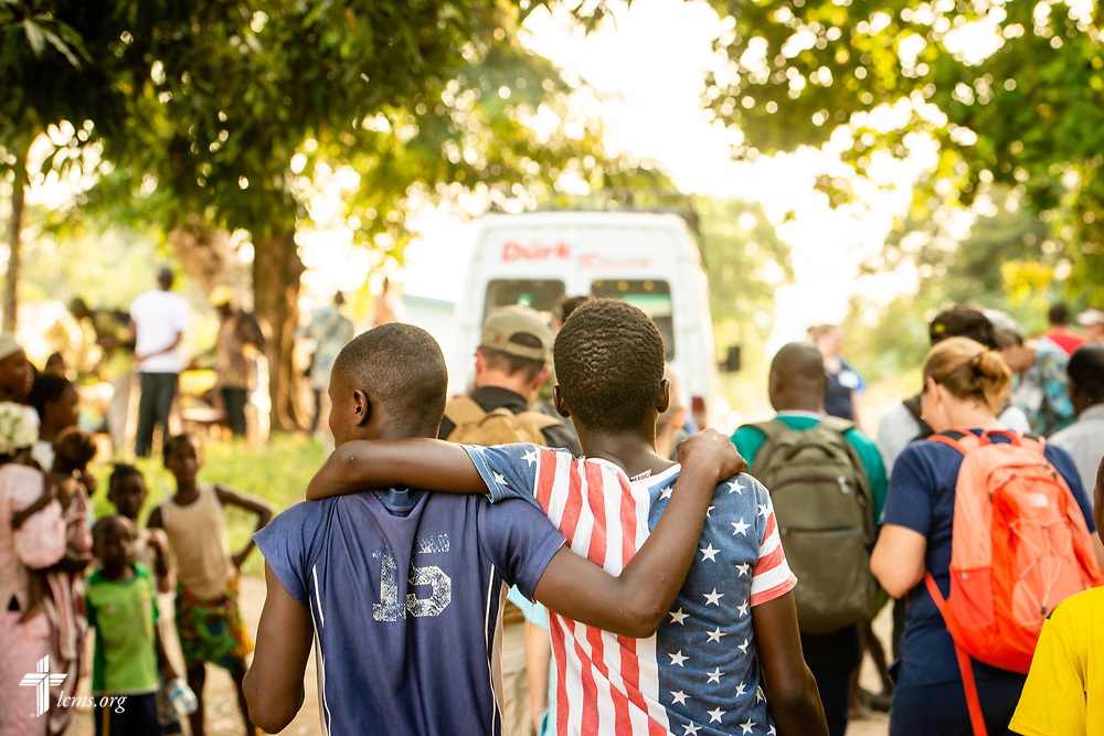 Residents watch as team members depart for their accommodations following the second day of the LCMS Mercy Medical Team on Tuesday, May 8, 2018, in the Yardu village outside Koidu, Sierra Leone, West Africa. LCMS Communications/Erik M. Lunsford