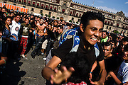 Adolescents mosh during a punk rock concert in the Zocalo, Mexico City's central square, on June 13, 2008.