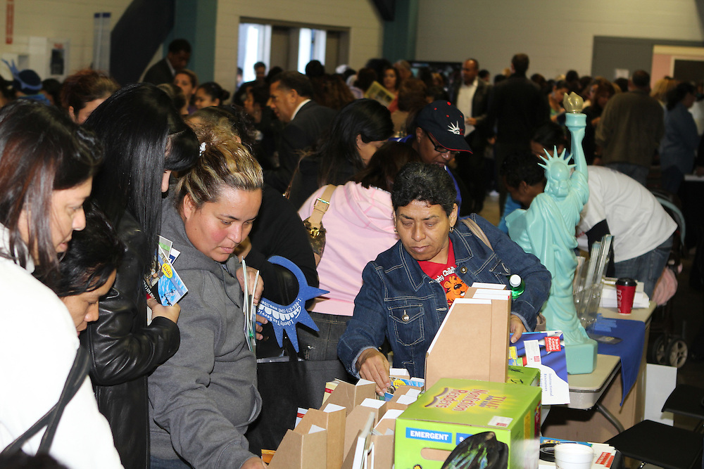 Parents scan tables of information at the annual Parent Involvement Day. The celebration recognizes the role of parents as their children's first teachers and offers fresh approaches to supporting educational and personal growth. Grandparents were the main theme of this year's celebration, with information on the Grandparents Prep Academy being offered.<br /> To submit photos for inclusion in eNews, send them to hisdphotos@yahoo.com.