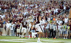 Texas A&M quarterback Trevor Knight (8) jogs into the end zone for the go ahead touchdown against UCLA in overtime of an NCAA college football game Saturday, Sept. 3, 2016, in College Station, Texas. Texas A&M won 31-24 in overtime. (AP Photo/Sam Craft)