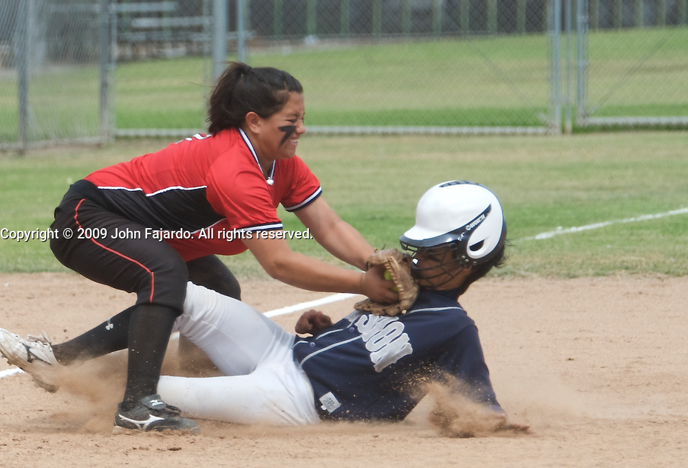 LBCC's Valentina Nabayan(left) puts the tag on Rosheema Wise(right) in the first round Southern California regional playoff match against Los Angeles Mission College at the LAC softball field on Saturday May 2, 2009.  The Vikings lose 3-2  in the first game of the best of three series.