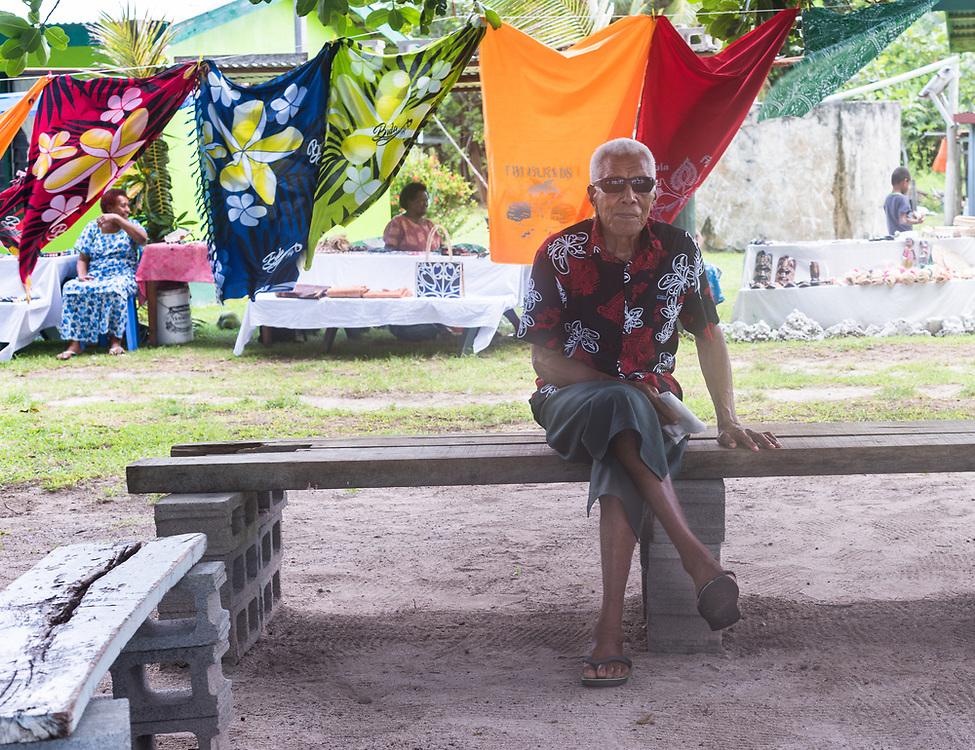 Yasawa-I-Rara, Fiji -- March 8, 2018. A Fijian man sits on a bench by an outdoor market. Editorial Use Only.