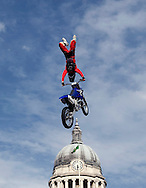 Riders in action at the Red Bull X-Fighters Jams in Nottingham's Old Market Square.