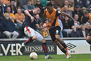 Hull City striker Abel Hernandez (9) and Rotherham United defender Richard Wood (6)  during the Sky Bet Championship match between Hull City and Rotherham United at the KC Stadium, Kingston upon Hull, England on 7 May 2016. Photo by Ian Lyall.