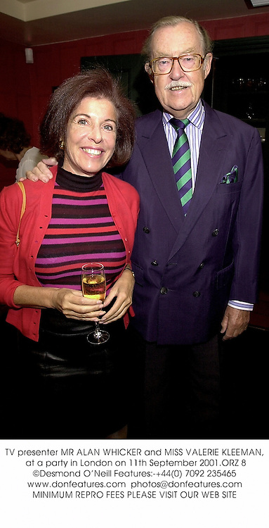 TV presenter MR ALAN WHICKER and MISS VALERIE KLEEMAN, at a party in London on 11th September 2001.	ORZ 8