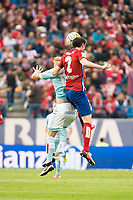 Atletico de Madrid's Godin and Celta de Vigo's Wass during La Liga Match at Vicente Calderon Stadium in Madrid. May 14, 2016. (ALTERPHOTOS/BorjaB.Hojas)