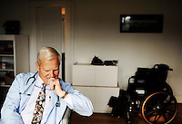 REEDVILLE, VA - DECEMBER 12:  With approximately 65 percent of his patients insured by Medicare, Rural Doctor Emery Lewis, considers a question from an older patient during an examination, in Reedville, Virginia, Monday, December 12, 2011. (Photo by Melina Mara/The Washington Post) . ...