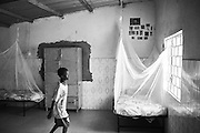 A boy inside a bedroom at a children's shelter in the city of Thiès, Senegal on April 28, 2015. Supported by OSIWA, organisation 'Pour un sourire d'enfant'  has implemented the sport of fencing as a form of restorative justice in a minor's prison for males and females in the city of Thiès, Senegal. Some of the participants also come from the children's shelter. This innovative judicial method works as a restorative rather than punitive approach to justice. Fencing is an effective method for helping incarcerated young people build self-confidence and respect (both for themselves and others), and engender discipline and determination.