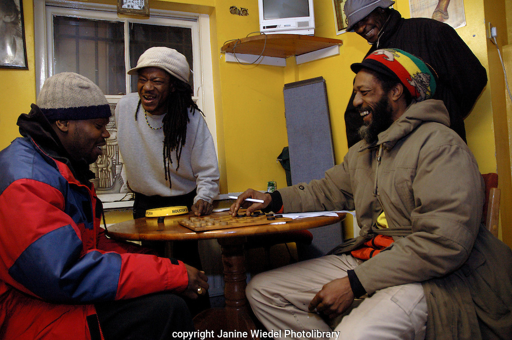 Playing draughts in the Rastafarian Community Centre in St Agnes Place Kenningto South London.