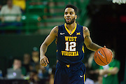 WACO, TX - MARCH 5: Tarik Phillip #12 of the West Virginia Mountaineers brings the ball up court against the Baylor Bears on March 5, 2016 at the Ferrell Center in Waco, Texas.  (Photo by Cooper Neill/Getty Images) *** Local Caption *** Tarik Phillip
