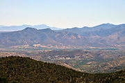 The town of Patagonia, Arizona, and the country of Mexico beyond, are seen from the Gardner Canyon Trail at the intersection of the Walker Basin Trail in the Santa Rita Mountains, Coronado National Forest, Arizona, USA.