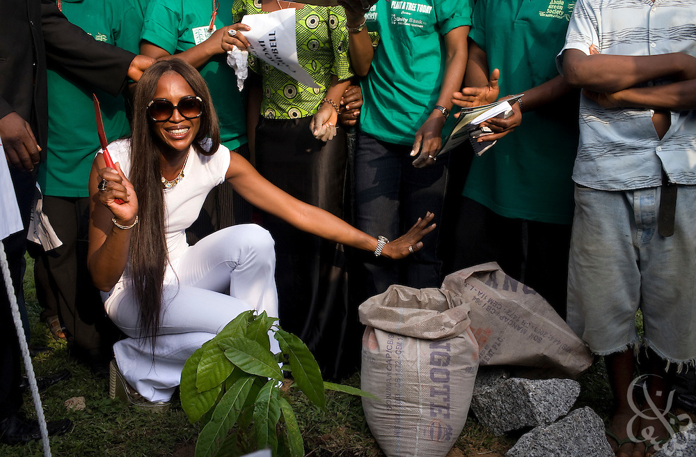 "Super model Naomi Campbell plants a cocoa tree at a ceremony in association with the 3rd annual ThisDay festival July 11, 2008 in Abuja, Nigeria. The ThisDay festival, themed ""Africa Rising"", is an effort to raise awareness of African issues and promote positive images of Africa using music, fashion and culture.."