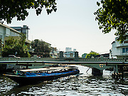11 APRIL 2016 - BANGKOK, THAILAND:   A khlong boat turns around near Phan Fa before starting its run out of Bangkok on Khlong Saen Saeb. The Khlong Saen Saep boat service is a water bus operating on the Saen Saep Canal in Bangkok through the city's traffic-congested commercial districts. The 18-kilometre route is served by 100 boats of 40-50 seats, and operates from 5:30am to 8:30pm daily on weekdays (7pm at the weekend). Prices are 8 to 20 baht, depending on distance traveled. The service carries about 60,000 passengers per day. It is run by a company called Family Transport.       PHOTO BY JACK KURTZ