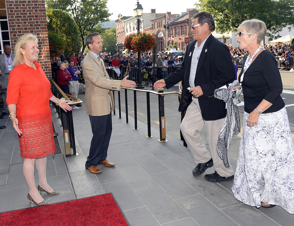 COOPERSTOWN, NY - JULY 26: Hall of Famer Carlton Fisk is greeted by HOF President Jeff Idelson and HOF Chairman Jane Forbes Clark during the annual Parade of Legends down Main Street in Cooperstown, New York on July 26, 2014.