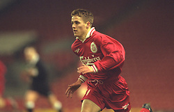 LIVERPOOL, ENGLAND - Tuesday, January 7, 1997: Liverpool's Michael Owen in action against Manchester United during the FA Youth Cup match at Anfield. United won 2-1. (Pic by David Rawcliffe/Propaganda)