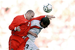 MINSK, BELARUS - Saturday, September 4, 1999: Wales's Robert Page and Belarus's Vasily Baranov battle for the ball during the UEFA Euro 2000 Qualifying Group One match at the Dinamo Stadium. (Mandatory credit: David Rawcliffe/Propaganda)