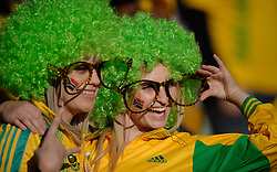 Two female fans of South Africa wearing glasses and green afro wigs pose for the cameras during the warm up, France v South Africa, FIFA World Cup 2010 Group A, Free State Stadium, Bloemfontein, South Africa, Date 22062010 Picture by Marc Atkins Mobile +27 8200 97621 (IPS PHOTO AGENCY) - 21 Delisle road - London SE28 0JD- tel: 020 88 55 1 008 - fax: 020 88 55 1037 - ISDN: 020 88 55 1039. / SPORTIDA PHOTO AGENCY