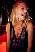 BLONDE GIRL LAUGHING IN CLUB