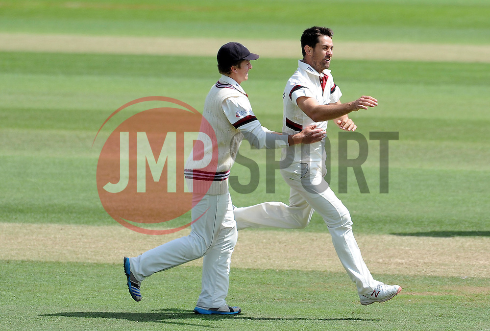 Somerset's Tim Groenewald celebrates with Somerset's Tom Abell after dismissing Nottinghamshire's Riki Wessels. - Photo mandatory by-line: Harry Trump/JMP - Mobile: 07966 386802 - 15/06/15 - SPORT - CRICKET - LVCC County Championship - Division One - Day Two - Somerset v Nottinghamshire - The County Ground, Taunton, England.